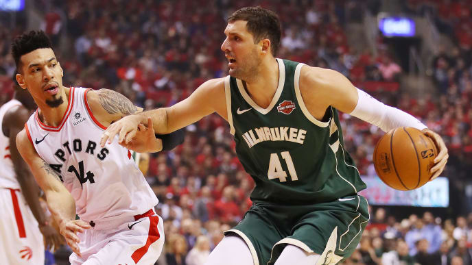 TORONTO, ONTARIO - MAY 21: Nikola Mirotic #41 of the Milwaukee Bucks dribbles against Danny Green #14 of the Toronto Raptors during the first half in game four of the NBA Eastern Conference Finals at Scotiabank Arena on May 21, 2019 in Toronto, Canada. NOTE TO USER: User expressly acknowledges and agrees that, by downloading and or using this photograph, User is consenting to the terms and conditions of the Getty Images License Agreement. (Photo by Gregory Shamus/Getty Images)