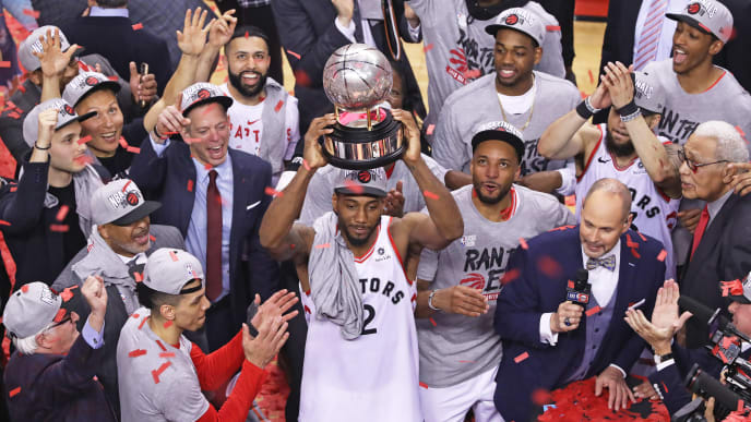TORONTO, ON - MAY 25:  Kawhi Leonard #2 of the Toronto Raptors hoists the Eastern Conference Championship trophy after defeating the Milwaukee Bucks in Game Six of the NBA Eastern Conference Final at Scotiabank Arena on May 25, 2019 in Toronto, Ontario, Canada. The Raptors defeated the Bucks 100-94 to win the Eastern Conference Championship 4 games to 2. NOTE TO USER: user expressly acknowledges and agrees by downloading and/or using this Photograph, user is consenting to the terms and conditions of the Getty Images Licence Agreement. (Photo by Claus Andersen/Getty Images)