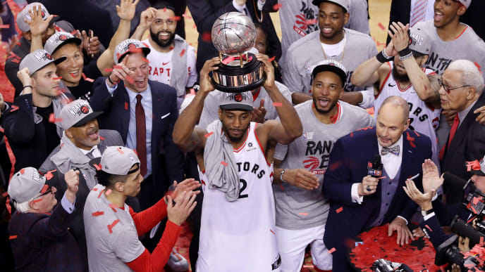 TORONTO, ONTARIO - MAY 25: Kawhi Leonard #2 of the Toronto Raptors celebrates with the Eastern Conference Finals trophy after defeating the Milwaukee Bucks 100-94 in game six of the NBA Eastern Conference Finals to advance to the 2019 NBA Finals at Scotiabank Arena on May 25, 2019 in Toronto, Canada. NOTE TO USER: User expressly acknowledges and agrees that, by downloading and or using this photograph, User is consenting to the terms and conditions of the Getty Images License Agreement. (Photo by Claus Andersen/Getty Images)