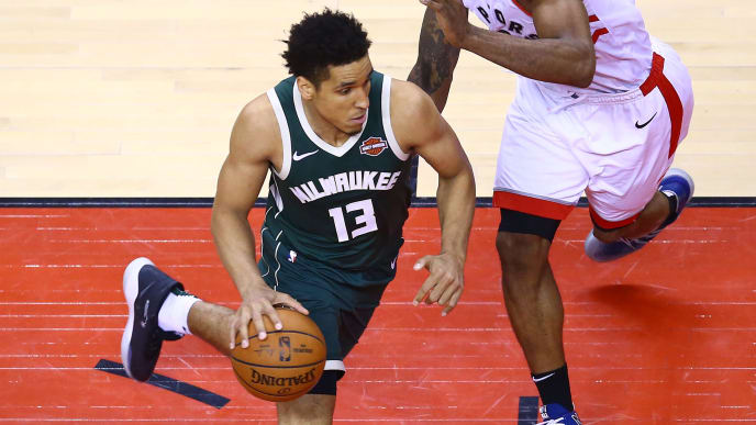 TORONTO, ONTARIO - MAY 19: Malcolm Brogdon #13 of the Milwaukee Bucks drives to the basket against Kawhi Leonard #2 of the Toronto Raptors during the second half in game three of the NBA Eastern Conference Finals at Scotiabank Arena on May 19, 2019 in Toronto, Canada. NOTE TO USER: User expressly acknowledges and agrees that, by downloading and or using this photograph, User is consenting to the terms and conditions of the Getty Images License Agreement. (Photo by Vaughn Ridley/Getty Images)