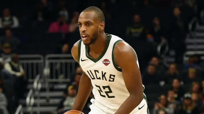 MILWAUKEE, WISCONSIN - OCTOBER 17:  Khris Middleton #22 of the Milwaukee Bucks handles the ball during a game against the Minnesota Timberwolves at Fiserv Forum on October 17, 2019 in Milwaukee, Wisconsin. NOTE TO USER: User expressly acknowledges and agrees that, by downloading and or using this photograph, User is consenting to the terms and conditions of the Getty Images License Agreement.  (Photo by Stacy Revere/Getty Images)