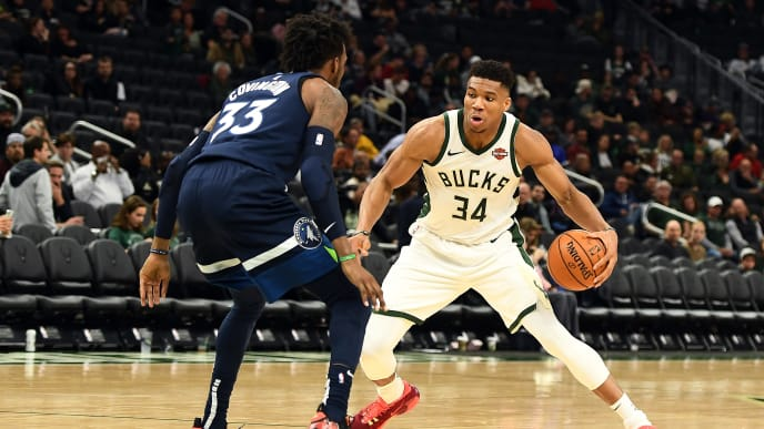 MILWAUKEE, WISCONSIN - OCTOBER 17:  Giannis Antetokounmpo #34 of the Milwaukee Bucks is defended by Robert Covington #33 of the Minnesota Timberwolves during a game at Fiserv Forum on October 17, 2019 in Milwaukee, Wisconsin. NOTE TO USER: User expressly acknowledges and agrees that, by downloading and or using this photograph, User is consenting to the terms and conditions of the Getty Images License Agreement.  (Photo by Stacy Revere/Getty Images)