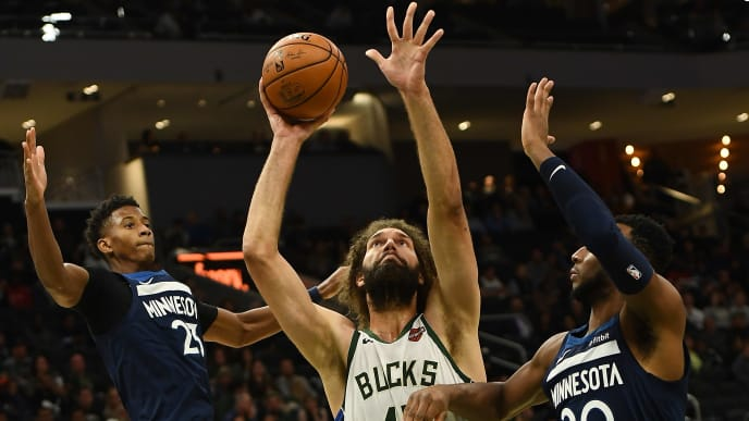 MILWAUKEE, WISCONSIN - OCTOBER 17: Robin Lopez #42 of the Milwaukee Bucks is defended by Jarrett Culver #23 and Josh Okogie #20 of the Minnesota Timberwolves during the second half at Fiserv Forum on October 17, 2019 in Milwaukee, Wisconsin. NOTE TO USER: User expressly acknowledges and agrees that, by downloading and or using this photograph, User is consenting to the terms and conditions of the Getty Images License Agreement. (Photo by Stacy Revere/Getty Images)