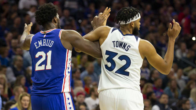 PHILADELPHIA, PA - OCTOBER 30: Joel Embiid #21 of the Philadelphia 76ers gets tangled up with Karl-Anthony Towns #32 of the Minnesota Timberwolves in the third quarter at the Wells Fargo Center on October 30, 2019 in Philadelphia, Pennsylvania. The 76ers defeated the Wolves 117-95. NOTE TO USER: User expressly acknowledges and agrees that, by downloading and or using this photograph, User is consenting to the terms and conditions of the Getty Images License Agreement. (Photo by Mitchell Leff/Getty Images)