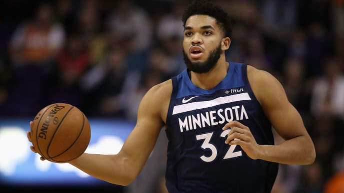 PHOENIX, ARIZONA - JANUARY 22:  Karl-Anthony Towns #32 of the Minnesota Timberwolves handles the ball during the first half of the NBA game against the Phoenix Suns at Talking Stick Resort Arena on January 22, 2019 in Phoenix, Arizona. (Photo by Christian Petersen/Getty Images)