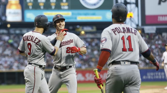 CHICAGO, ILLINOIS - JULY 26: Max Kepler #26 of the Minnesota Twins is congratulated by Marwin Gonzalez #9 following his three run home run during the second inning of a game against the Chicago White Sox  at Guaranteed Rate Field on July 26, 2019 in Chicago, Illinois. (Photo by Nuccio DiNuzzo/Getty Images)