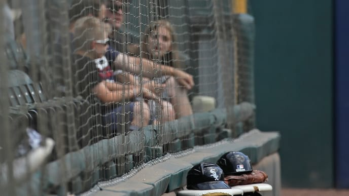 CHICAGO, ILLINOIS - JULY 28:  Fans sit behind a newly installed safety screen that runs from foul pole to foul poll at Guaranteed Rate Field before the Chicago White Sox take on the Minnesota Twins on July 28, 2019 in Chicago, Illinois. (Photo by Jonathan Daniel/Getty Images)