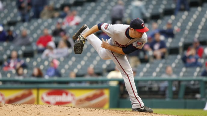 CLEVELAND, OH - SEPTEMBER 11:  Caleb Thielbar #56 of the Minnesota Twins pitches against the Cleveland Indians during the eighth inning of the second game a doubleheader on September 11, 2014 at Progressive Field in Cleveland, Ohio.  The Indians defeated the Twins 2-0.  (Photo by David Maxwell/Getty Images)
