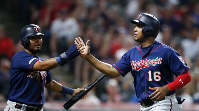 CLEVELAND, OH - JULY 13: Jonathan Schoop #16 and Luis Arraez #2 of the Minnesota Twins celebrate after scoring on a double hit by Jake Cave #60 off Tyler Clippard #36 of the Cleveland Indians during the eighth inning at Progressive Field on July 13, 2019 in Cleveland, Ohio. Minnesota defeats Cleveland 6-2. (Photo by Ron Schwane/Getty Images)