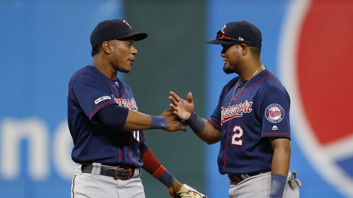 CLEVELAND, OH - JULY 12: Jorge Polanco #11 and Luis Arraez #2 of the Minnesota Twins celebrate a 5-3 victory over the Cleveland Indians at Progressive Field on July 12, 2019 in Cleveland, Ohio. (Photo by Ron Schwane/Getty Images)