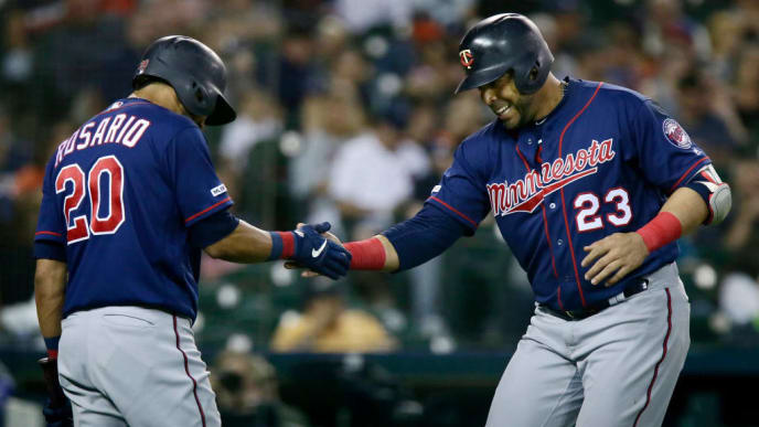 DETROIT, MI - JUNE 7:  Nelson Cruz #23 of the Minnesota Twins celebrates his solo home run that broke a 3-3 tie against the Detroit Tigers with Eddie Rosario #20 of the Minnesota Twins during the eighth inning at Comerica Park on June 7, 2019 in Detroit, Michigan. The Twins defeated the Tigers 6-3. (Photo by Duane Burleson/Getty Images)