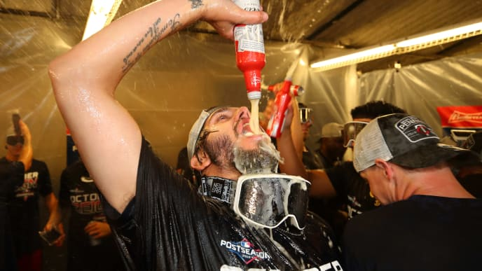 DETROIT, MICHIGAN - SEPTEMBER 25: Lewis Thorpe #43 of the Minnesota Twins celebrates winning the American League Central Division title after a 5-1 win against the Detroit Tigers and a Cleveland Indian loss at Comerica Park on September 25, 2019 in Detroit, Michigan. (Photo by Gregory Shamus/Getty Images)