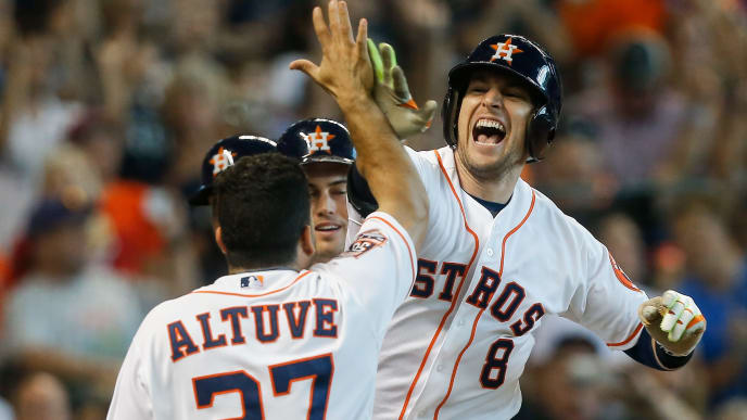 HOUSTON, TX - SEPTEMBER 06:  Jed Lowrie #8 of the Houston Astros is congratulated by Jose Altuve #27, Jake Marisnick #6 and Preston Tucker #20 after hittinga grand slam in the seventh inning against the Minnesota Twins at Minute Maid Park on September 6, 2015 in Houston, Texas.  (Photo by Bob Levey/Getty Images)