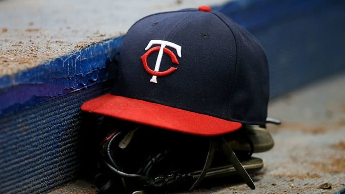 MILWAUKEE, WI - APRIL 21:  A Minnesota Twins hat and glove sit in the dugout during the game against the Milwaukee Brewers at Miller Park on April 21, 2016 in Milwaukee, Wisconsin. (Photo by Dylan Buell/Getty Images) *** Local Caption ***
