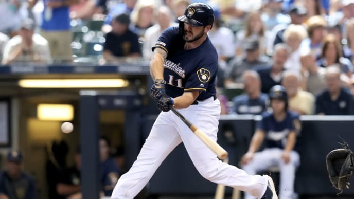 MILWAUKEE, WISCONSIN - AUGUST 14:  Mike Moustakas #11 of the Milwaukee Brewers hits a double in the fifth inning against the Minnesota Twins at Miller Park on August 14, 2019 in Milwaukee, Wisconsin. (Photo by Dylan Buell/Getty Images)
