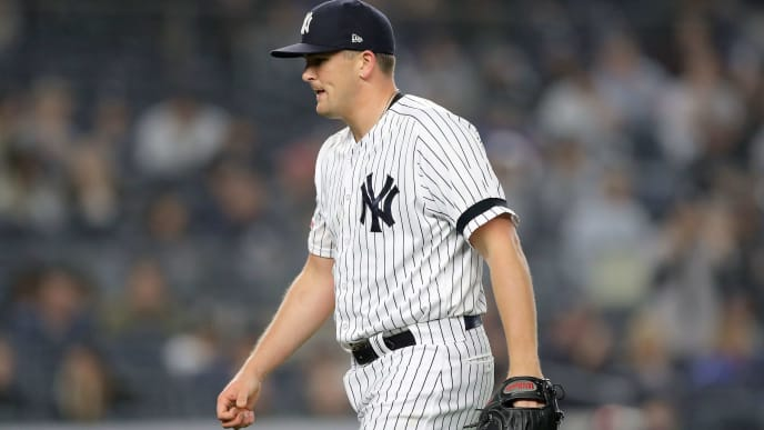 NEW YORK, NEW YORK - MAY 03:  Jonathan Holder #56 of the New York Yankees reacts at the end of the fourth inning against the Minnesota Twins at Yankee Stadium on May 03, 2019 in the Bronx borough of New York City. (Photo by Elsa/Getty Images)