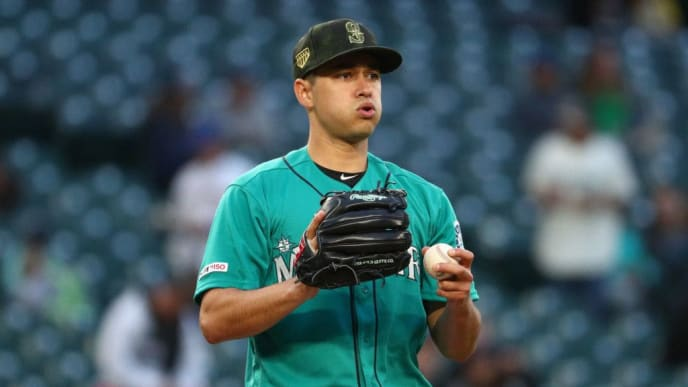 SEATTLE, WASHINGTON - MAY 17: Marco Gonzales #7 of the Seattle Mariners reacts after giving up a hit in the fourth inning against the Minnesota Twins during their game at T-Mobile Park on May 17, 2019 in Seattle, Washington. (Photo by Abbie Parr/Getty Images)