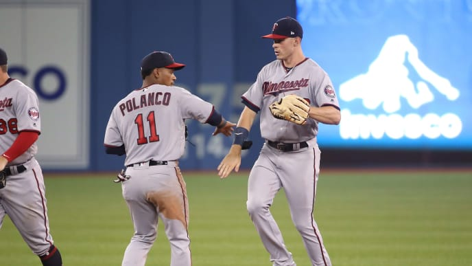 TORONTO, ON - JULY 23: Max Kepler #26 of the Minnesota Twins celebrates their victory with Jorge Polanco #11 during MLB game action against the Toronto Blue Jays at Rogers Centre on July 23, 2018 in Toronto, Canada. (Photo by Tom Szczerbowski/Getty Images)