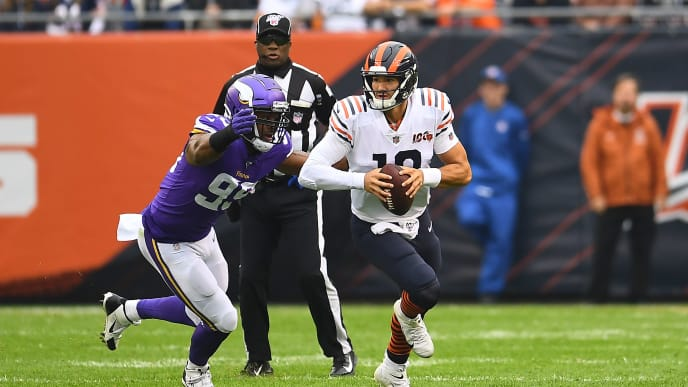 CHICAGO, ILLINOIS - SEPTEMBER 29:  Mitchell Trubisky #10 of the Chicago Bears loses the ball after being hit by Danielle Hunter #99 of the Minnesota Vikings during a game at Soldier Field on September 29, 2019 in Chicago, Illinois. The Bears defeated the Vikings 16-6.  (Photo by Stacy Revere/Getty Images)