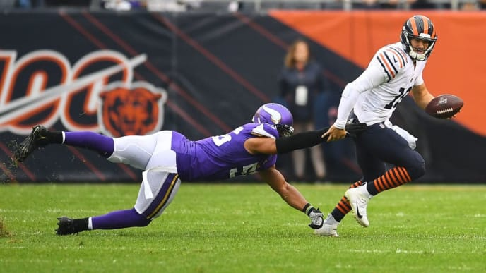 CHICAGO, ILLINOIS - SEPTEMBER 29:  Mitchell Trubisky #10 of the Chicago Bears avoids a tackle by Anthony Barr #55 of the Minnesota Vikings during a game at Soldier Field on September 29, 2019 in Chicago, Illinois. The Bears defeated the Vikings 16-6.  (Photo by Stacy Revere/Getty Images)