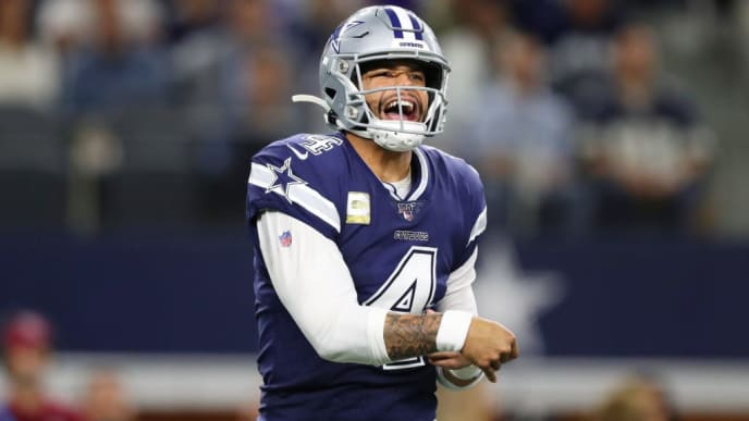 ARLINGTON, TEXAS - NOVEMBER 10: Dak Prescott #4 of the Dallas Cowboys reacts as he throws a pass during the first half against the Minnesota Vikings at AT&T Stadium on November 10, 2019 in Arlington, Texas. (Photo by Tom Pennington/Getty Images)
