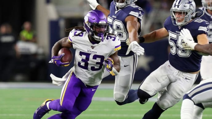 ARLINGTON, TEXAS - NOVEMBER 10: Dalvin Cook #33 of the Minnesota Vikings runs against the Dallas Cowboys including Leighton Vander Esch #55  and Xavier Woods #25 at AT&T Stadium on November 10, 2019 in Arlington, Texas. (Photo by Richard Rodriguez/Getty Images)