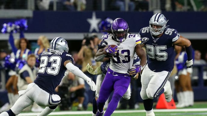 ARLINGTON, TEXAS - NOVEMBER 10: Darian Thompson #23 and Christian Covington #95 of the Dallas Cowboys try to stop the run by Dalvin Cook #33 of the Minnesota Vikings in the fourth quarter at AT&T Stadium on November 10, 2019 in Arlington, Texas. (Photo by Richard Rodriguez/Getty Images)