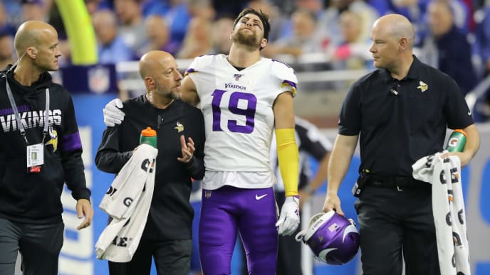 DETROIT, MI - OCTOBER 20: Adam Thielen #19 of the Minnesota Vikings is helped off the field after his first quarter touchdown catch against the Detroit Lions at Ford Field on October 20, 2019 in Detroit, Michigan. (Photo by Rey Del Rio/Getty Images)