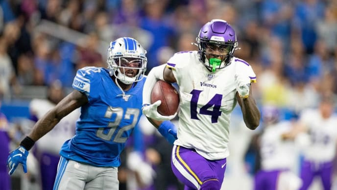 DETROIT, MI - OCTOBER 20: Stefon Diggs #14 of the Minnesota Vikings catches a late fourth quarter pass as Tavon Wilson #32 of the Detroit Lions gives chase during the game at Ford Field on October 20, 2019 in Detroit, Michigan. Minnesota defeated Detroit 42-30. (Photo by Leon Halip/Getty Images)