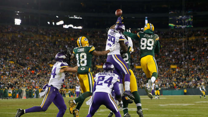 GREEN BAY, WI - JANUARY 03:  Aaron Rodgers #12 of the Green Bay Packers is unable to complete a hail mary pass during the fourth quarter against the Minnesota Vikings at Lambeau Field on January 3, 2016 in Green Bay, Wisconsin.  (Photo by Jon Durr/Getty Images)