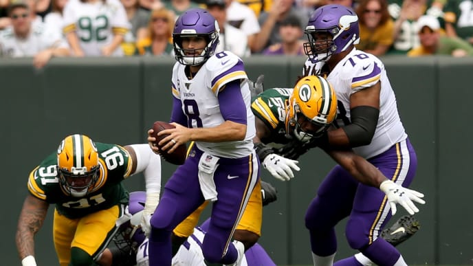 GREEN BAY, WISCONSIN - SEPTEMBER 15: Quarterback Kirk Cousins #8 of the Minnesota Vikings runs the ball against the Green Bay Packers in the game at Lambeau Field on September 15, 2019 in Green Bay, Wisconsin. (Photo by Dylan Buell/Getty Images)
