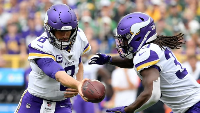 GREEN BAY, WISCONSIN - SEPTEMBER 15:  Kirk Cousins #8 of the Minnesota Vikings hands the ball off to Dalvin Cook #33 in the second quarter against the Green Bay Packers at Lambeau Field on September 15, 2019 in Green Bay, Wisconsin. (Photo by Quinn Harris/Getty Images)