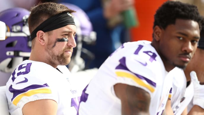 KANSAS CITY, MISSOURI - NOVEMBER 03: Adam Thielen #19 and Stefon Diggs #14 of the Minnesota Vikings look on from the sideline during the first half against the Kansas City Chiefs at Arrowhead Stadium on November 03, 2019 in Kansas City, Missouri. (Photo by Jamie Squire/Getty Images)