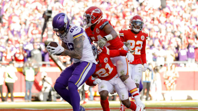 KANSAS CITY, MO - NOVEMBER 03: Kyle Rudolph #82 of the Minnesota Vikings catches a 3-yard touchdown pass in the third quarter behind the defense of Bashaud Breeland #21 of the Kansas City Chiefs and Damien Wilson #54 of the Kansas City Chiefs at Arrowhead Stadium on November 3, 2019 in Kansas City, Missouri. (Photo by David Eulitt/Getty Images)