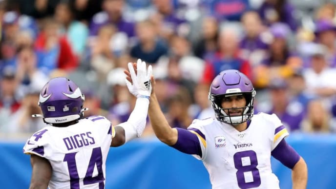 EAST RUTHERFORD, NEW JERSEY - OCTOBER 06:  Kirk Cousins #8 of the Minnesota Vikings congratulates Stefon Diggs #14 after a catch in the fourth quarter against the New York Giants at MetLife Stadium on October 06, 2019 in East Rutherford, New Jersey. (Photo by Elsa/Getty Images)