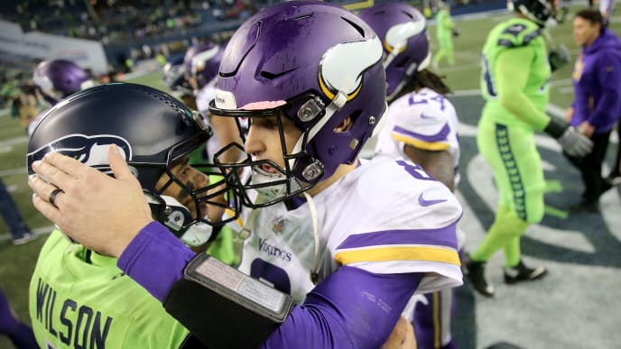 SEATTLE, WA - DECEMBER 10: Russell Wilson #3 of the Seattle Seahawks and Kirk Cousins #8 of the Minnesota Vikings hug after the Seattle Seahawks defeated the Minnesota Vikings 21-0 during their game at CenturyLink Field on December 10, 2018 in Seattle, Washington.  (Photo by Abbie Parr/Getty Images)