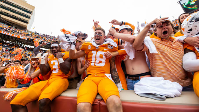 KNOXVILLE, TN - OCTOBER 12: Eric Gray #3 and Brian Maurer #18 of the Tennessee Volunteers celebrate with fans after defeating the Mississippi State Bulldogs at Neyland Stadium on October 12, 2019 in Knoxville, Tennessee. (Photo by Carmen Mandato/Getty Images)