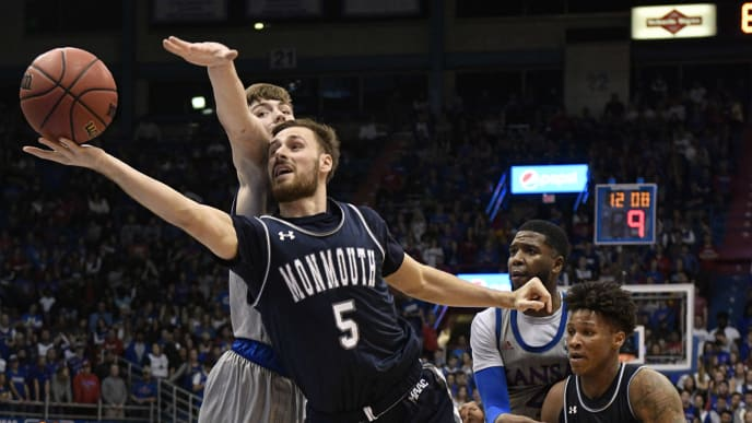 LAWRENCE, KANSAS - NOVEMBER 15: George Papas #5 of the Monmouth Hawks lays the ball up against Christian Braun #2 of the Kansas Jayhawks in the second half at Allen Fieldhouse on November 15, 2019 in Lawrence, Kansas. (Photo by Ed Zurga/Getty Images)