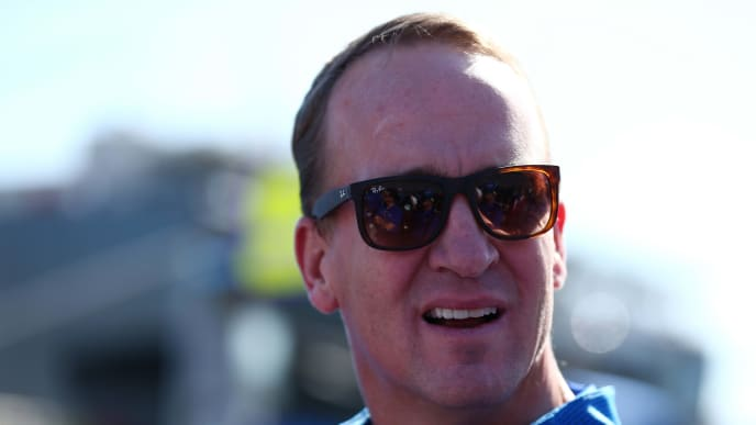 DAYTONA BEACH, FL - FEBRUARY 18:  Two-time Super Bowl winning quarterback Peyton Manning stands on the grid prior to the Monster Energy NASCAR Cup Series 60th Annual Daytona 500 at Daytona International Speedway on February 18, 2018 in Daytona Beach, Florida.  (Photo by Sarah Crabill/Getty Images)