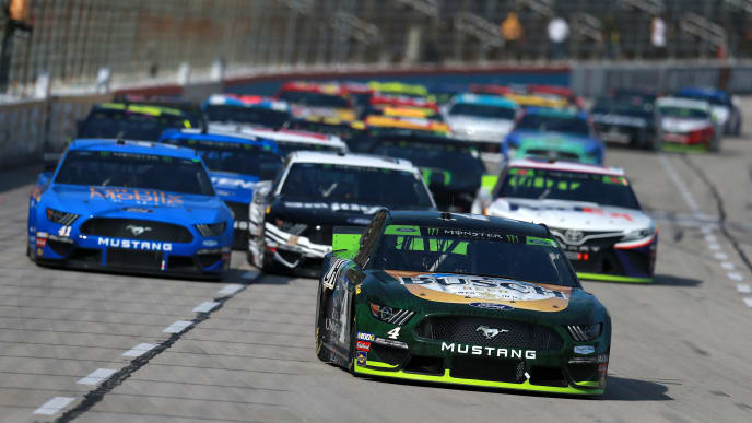FORT WORTH, TEXAS - NOVEMBER 03: Kevin Harvick, driver of the #4 Busch Beer/Ducks Unlimited Ford, leads the field during the Monster Energy NASCAR Cup Series AAA Texas 500 at Texas Motor Speedway on November 03, 2019 in Fort Worth, Texas. (Photo by Sean Gardner/Getty Images)