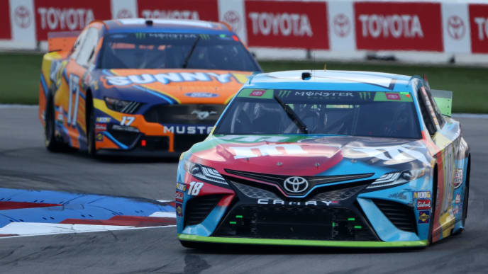 CHARLOTTE, NORTH CAROLINA - SEPTEMBER 29: Kyle Busch, driver of the #18 M&M's Hazelnut Toyota, leads a pack of cars during the Monster Energy NASCAR Cup Series Bank of America ROVAL 400 at Charlotte Motor Speedway on September 29, 2019 in Charlotte, North Carolina. (Photo by Brian Lawdermilk/Getty Images)