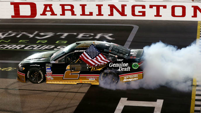 DARLINGTON, SC - SEPTEMBER 02: Brad Keselowski, driver of the #2 Miller Genuine Draft Ford, celebrates with a burnout after winning the Monster Energy NASCAR Cup Series Bojangles' Southern 500 at Darlington Raceway on September 2, 2018 in Darlington, South Carolina. (Photo by Sarah Crabill/Getty Images)