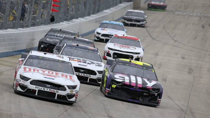 DOVER, DELAWARE - OCTOBER 06: Corey LaJoie, driver of the #32 Drydene Ford, and Jimmie Johnson, driver of the #48 Ally Chevrolet, lead a pack of cars during the Monster Energy NASCAR Cup Series Drydene 400 at Dover International Speedway on October 06, 2019 in Dover, Delaware. (Photo by Chris Trotman/Getty Images)