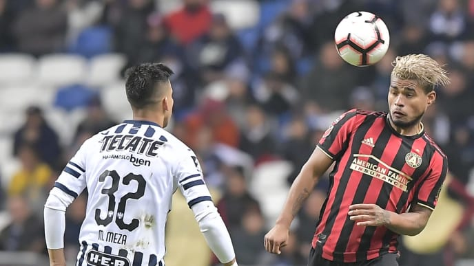 MONTERREY, MEXICO - MARCH 06: Maximiliano Meza of Monterrey observes as Josef Martinez of Atlanta United heads the ball during the quarterfinals first leg match between Monterrey and Atlanta United as part of the CONCACAF Champions League 2019 at BBVA Bancomer Stadium on March 06, 2019 in Monterrey, Mexico. (Photo by Azael Rodriguez/Getty Images)