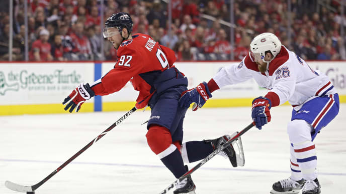 WASHINGTON, DC - APRIL 04: Evgeny Kuznetsov #92 of the Washington Capitals skates past Jeff Petry #26 of the Montreal Canadiens during the second period at Capital One Arena on April 04, 2019 in Washington, DC. (Photo by Patrick Smith/Getty Images)