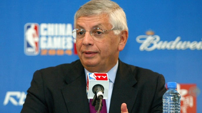 SHANGHAI, CHINA:  NBA Commissioner David Stern answers a question at a press conference ahead of the NBA pre-session match between Houston Rockets and Sacramento Kings at Shanghai Stadium, 14 October 2004. Chinese basketball superstar Yao Ming made his hometown fans proud Thursday as the Houston Rockets centre led his team to a close-fought win over the Sacramento Kings in a much-hyped NBA exhibition game. AFP PHOTO/LIU Jin  (Photo credit should read LIU JIN/AFP/Getty Images)
