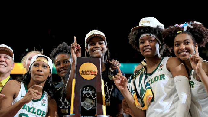 TAMPA, FLORIDA - APRIL 07:  Chloe Jackson #24, Kalani Brown #21, NaLyssa Smith #1 and DiDi Richards #2 of Baylor Lady Bears celebrate with the NCAA trophy after their teams 82-81 win over the Notre Dame Fighting Irish to win the championship game of the 2019 NCAA Women's Final Four at Amalie Arena on April 07, 2019 in Tampa, Florida. (Photo by Mike Ehrmann/Getty Images)