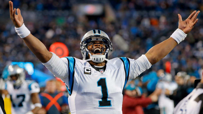 CHARLOTTE, NC - JANUARY 24:  Cam Newton #1 of the Carolina Panthers celebrates Ted Ginn Jr. #19 touchdown in the first quarter against the Arizona Cardinals during the NFC Championship Game at Bank of America Stadium on January 24, 2016 in Charlotte, North Carolina.  (Photo by Kevin C. Cox/Getty Images)