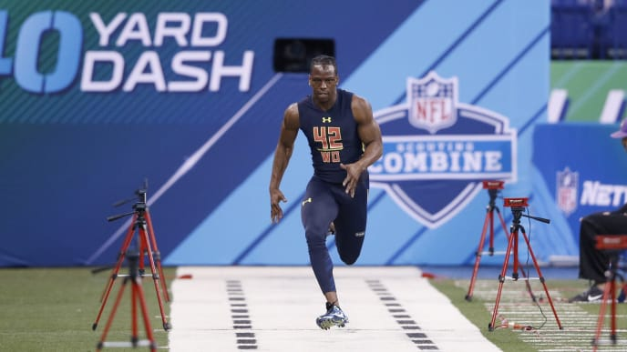 John Ross holds the NFL combine 40-Yard Dash record with a time of 4.22 seconds