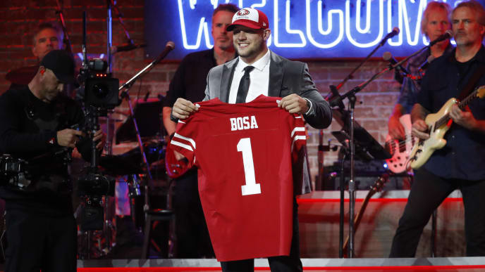 NASHVILLE, TENNESSEE - APRIL 25: Nick Bosa poses with a jersey after being picked 2nd overall by the San Francisco 49ers on day 1 of the 2019 NFL Draft on April 25, 2019 in Nashville, Tennessee. (Photo by Frederick Breedon/Getty Images)